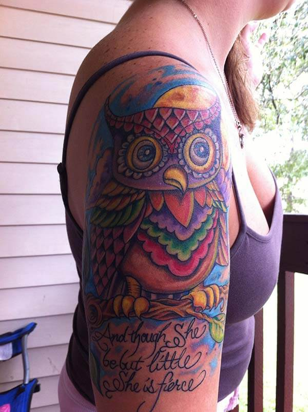 A mind blowing owl tattoo design on upper arm for women