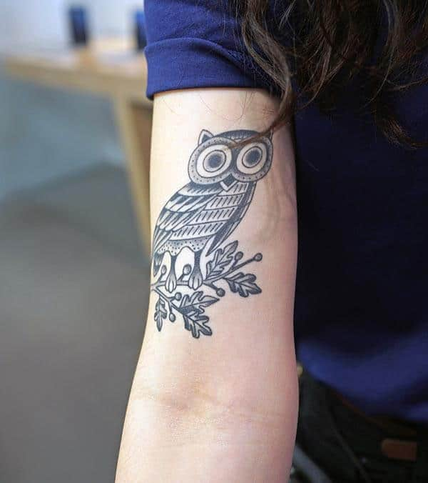 A breath taking owl tattoo design on upper arm for girls and women