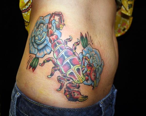 An eye-catchy scorpion tattoo design on side belly for Ladies