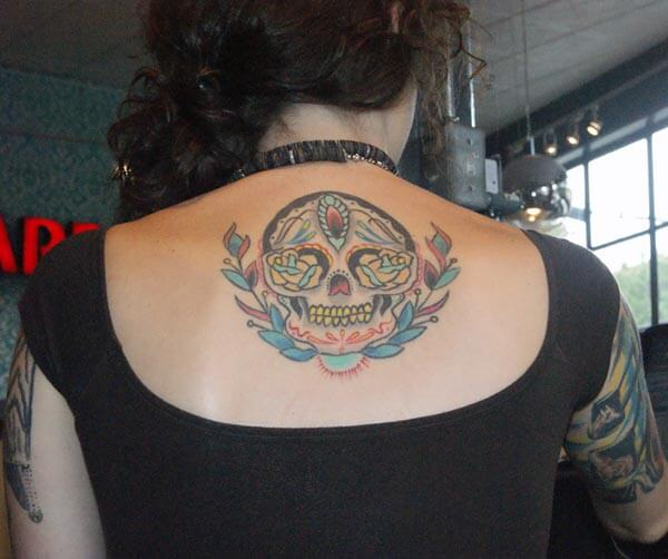 A catchy skull tattoo design on back shoulder for Girls and women