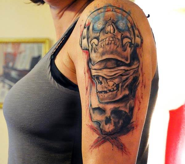 An intricate skull tattoo design on shoulder for Ladies
