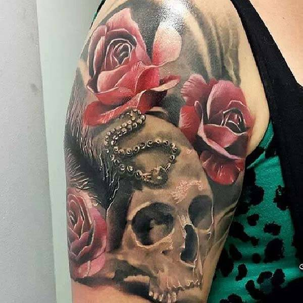 A jaw-dropping skull tattoo design on upper arm for Ladies