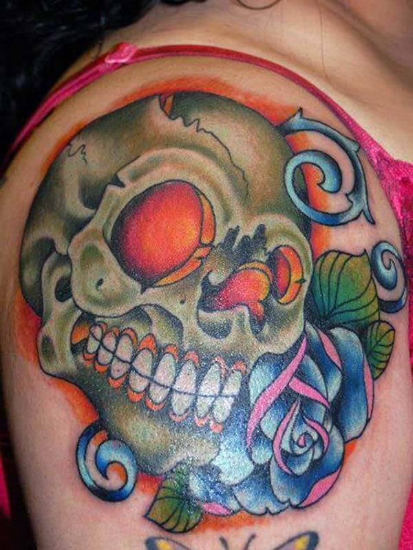 An engaging skull tattoo design on upper arm for girls and women