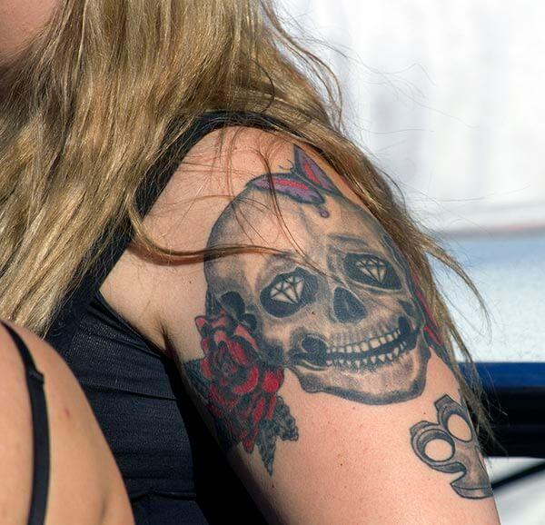An eye catchy skull tattoo design on shoulder for ladies