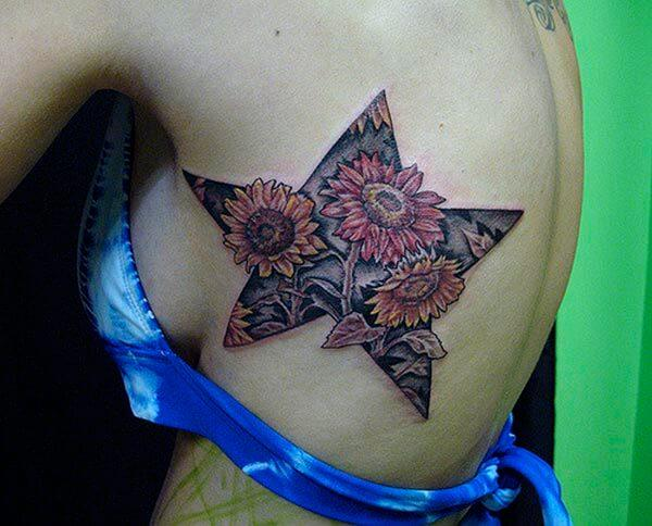 A captivating star tattoo design on back for women