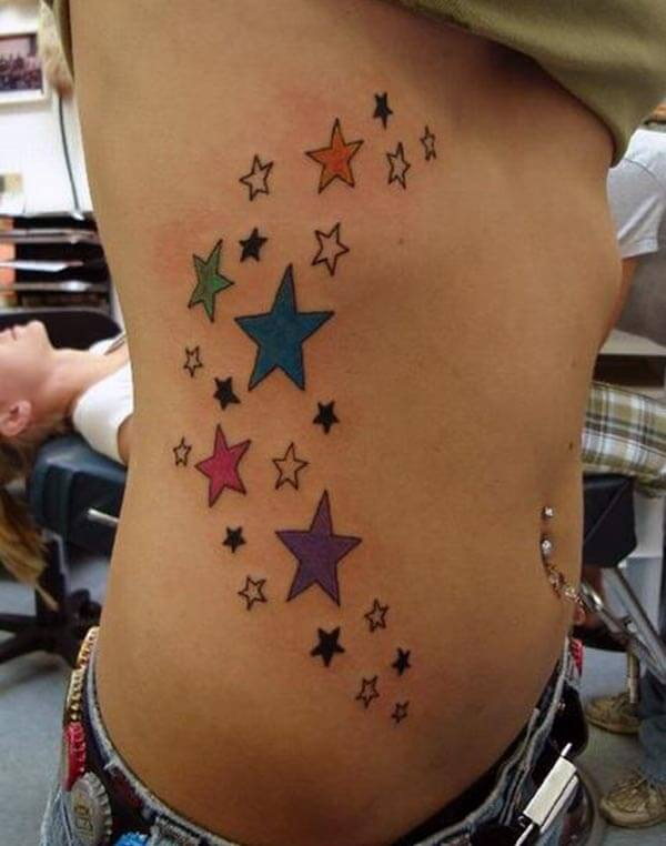 A vibrant star tattoo design on side belly for girls and women