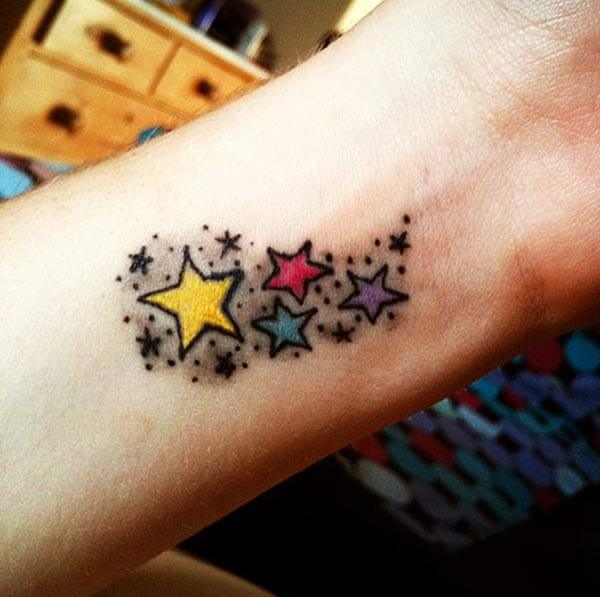 A catchy star tattoo design on wrist for Girls and ladies