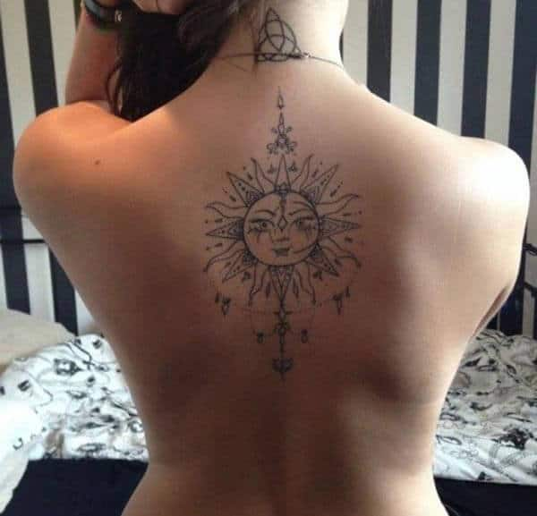 Lovely sun tattoo design on back for Ladies and women