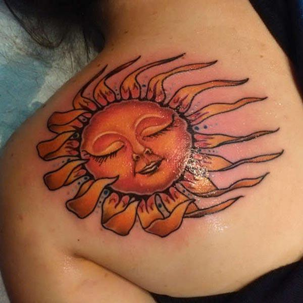 A mesmerizing sun tattoo design on side shoulder for Ladies