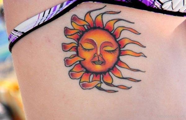 A vibrant cool sun tattoo design on side rib for Girls and women