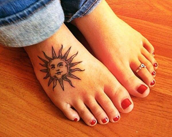 A cute sun tattoo design on feet for Girls