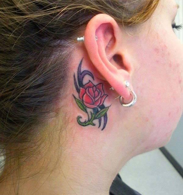 A catchy behind the ear tattoo design for girls