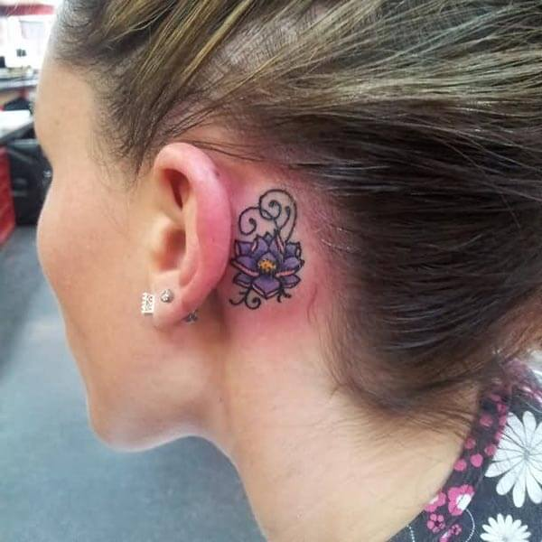 A violet floral behind the ear tattoo design for Women