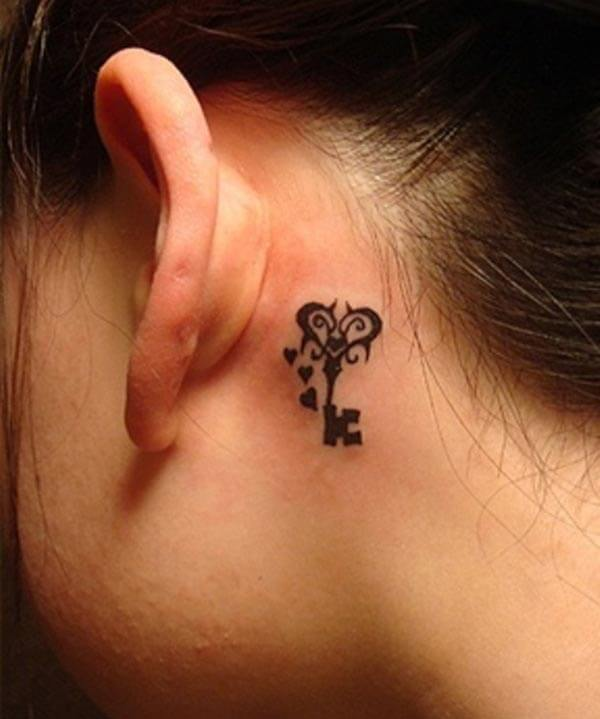 A brilliant behind the ear tattoo for girls
