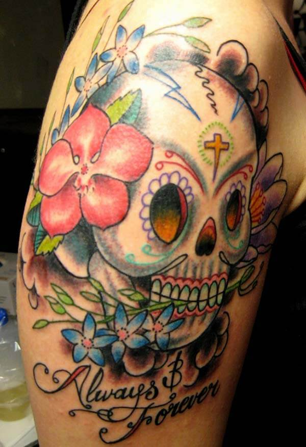 A colourful day of the dead tattoo design on arm for girls and women