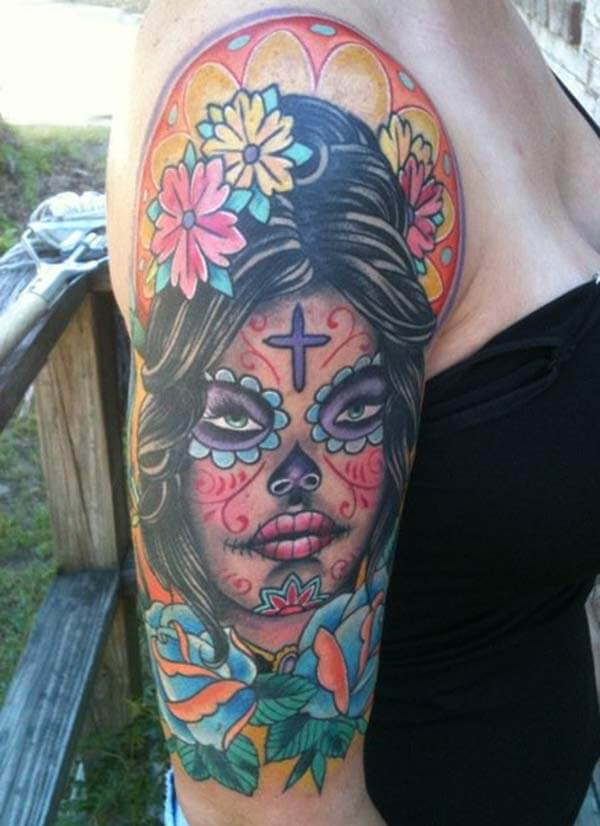 A vibrant and catchy day of the dead tattoo design on side shoulder for women