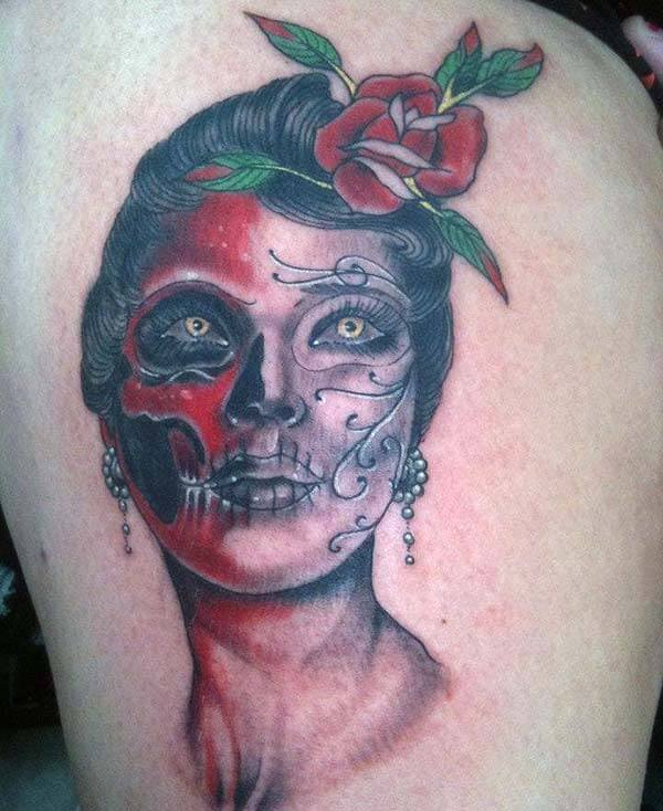 An eye catchy day of the dead tattoo design on back for Ladies