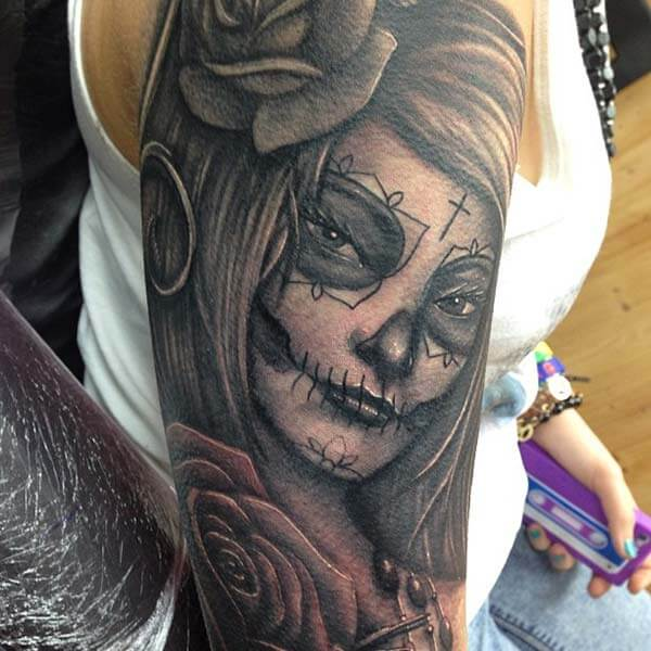An awesome black and white day of the dead tattoo design on shoulder for ladies