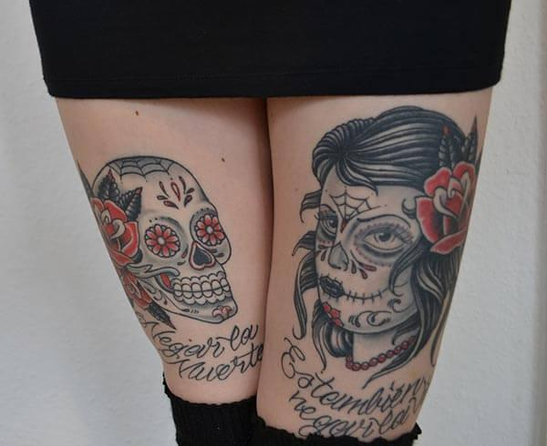 Cool day of the dead tattoo designs on thighs for girls