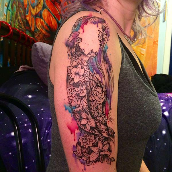 A magical floral tattoo design on half sleeve for girls and women
