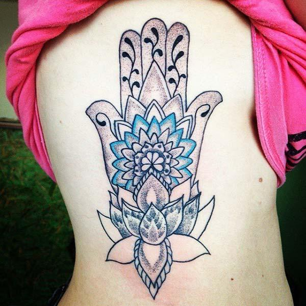 A beautiful hamsa tattoo design on side belly for girls and women