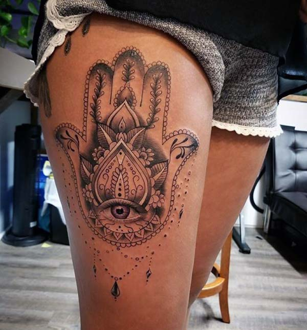 A breathtaking Hamsa tattoo design on thigh for women