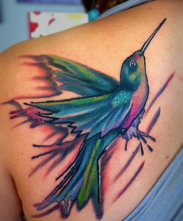 A captivating hummingbird tattoo design on back shoulder for girls