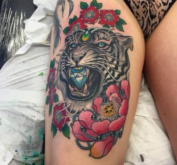 A mesmerizing tiger tattoo design on thigh for women