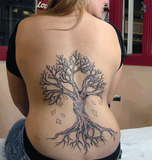 A fascinating tree tattoo design on back for women
