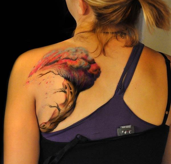 A mind blowing tree tattoo design on side shoulder for women