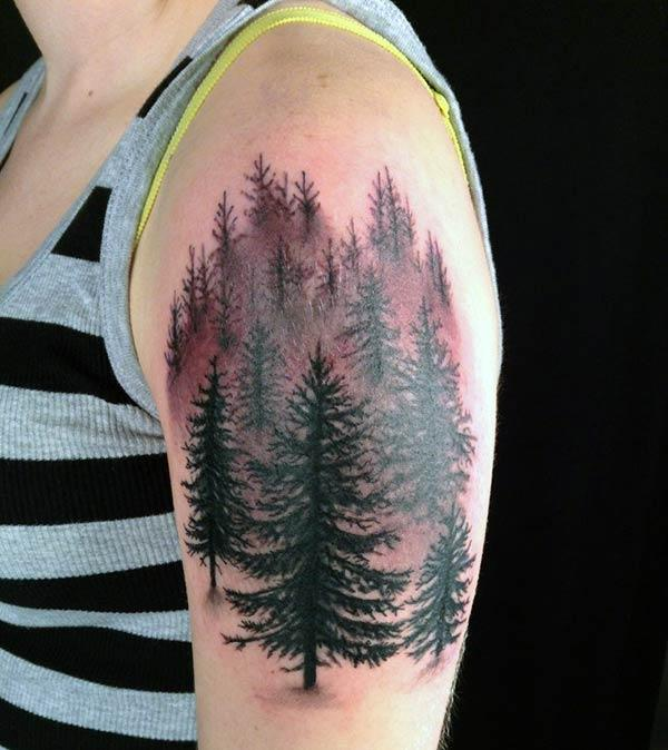 A striking tree tattoo design on shoulder for girls