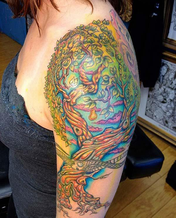 A vibrant tree tattoo design on shoulder for ladies