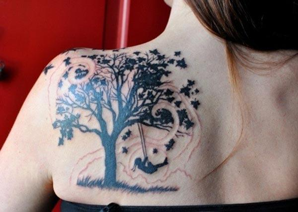 An enchanting tree tattoo design on back shoulder for girls