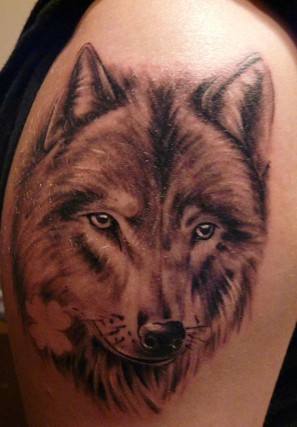 A lovely wolf tattoo design on shoulder for ladies