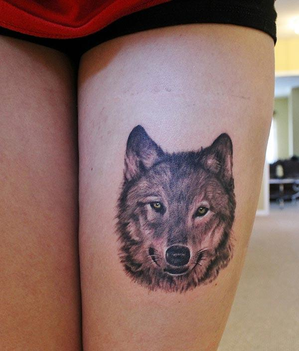 A pretty wolf tattoo design on thigh for Ladies