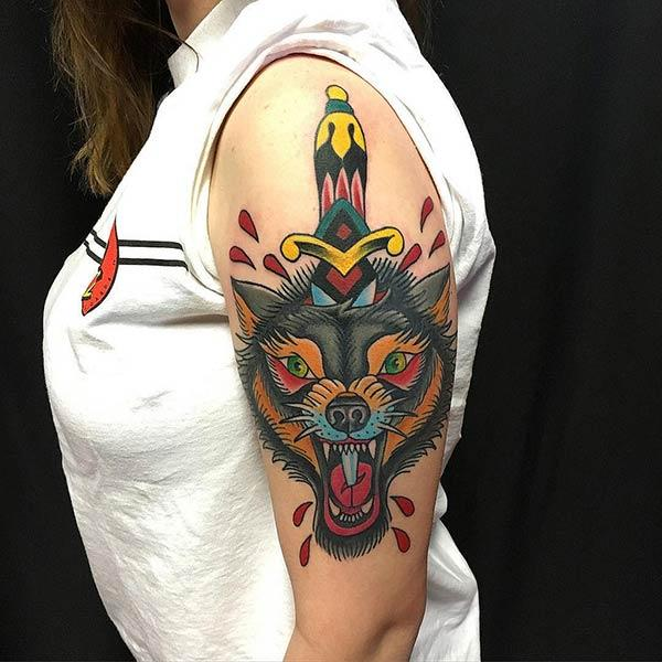 A jaw-dropping wolf tattoo design on shoulder for women