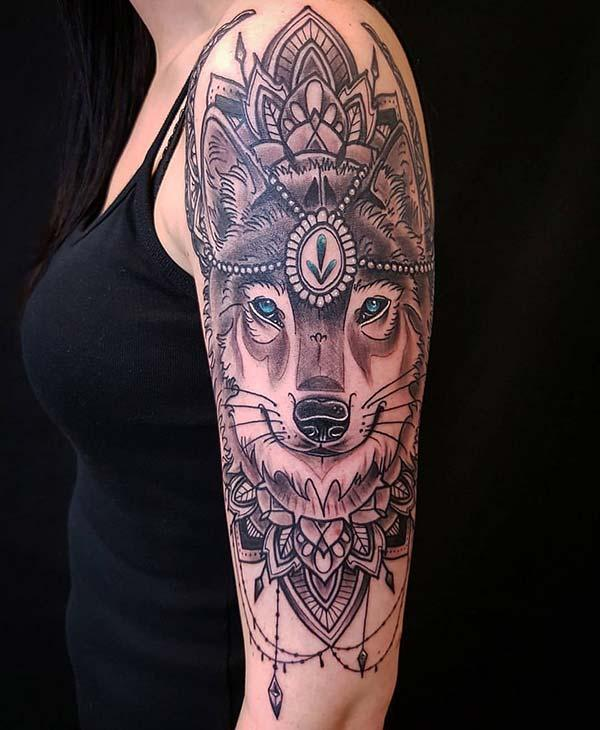 A heavenly wolf tattoo design on shoulder for girls and women