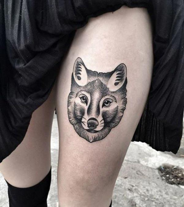 An appealing wolf tattoo design on thigh for Ladies