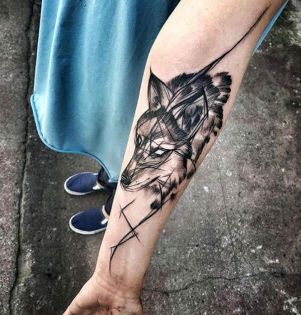 A unique wolf tattoo design on forearm for ladies