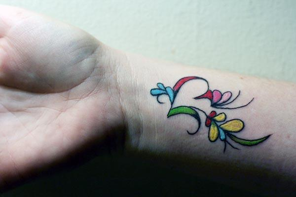 A lovely wrist tattoo design for ladies