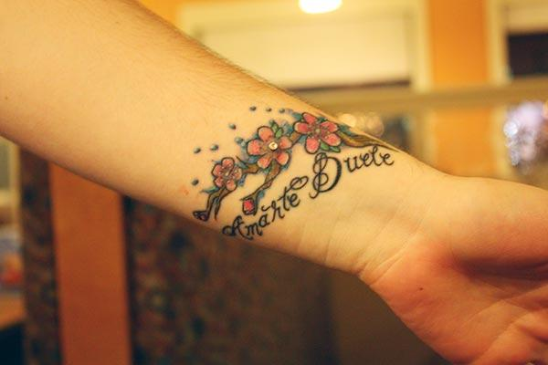 An eye catchy wrist tattoo design for women