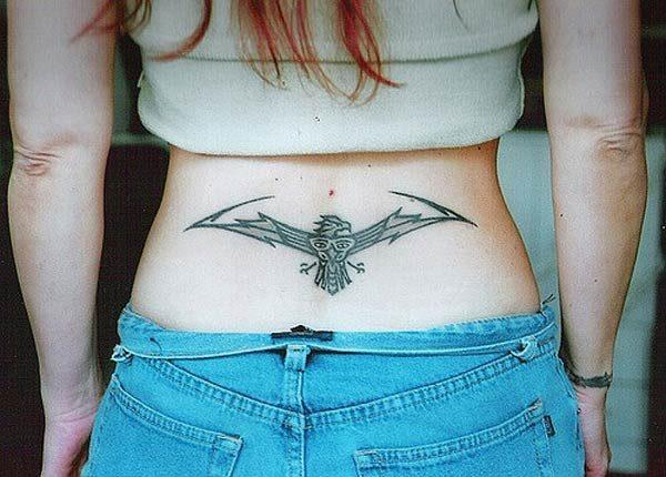 A catchy lower back tattoo design for Girls to try
