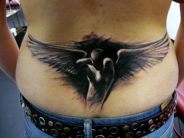 An awe-inspiring lower back tattoo for women