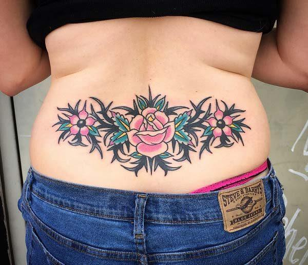A delightful lower back tattoo design for ladies